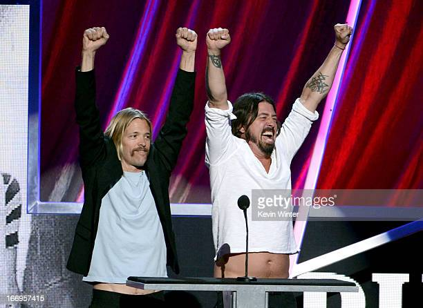 Presenters Taylor Hawkins and Dave Grohl of Foo Fighters speak onstage at the 28th Annual Rock and Roll Hall of Fame Induction Ceremony at Nokia...