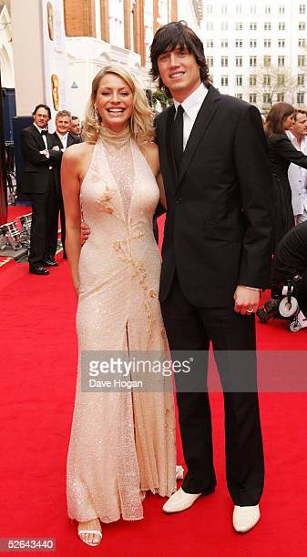 Presenters Tess Daly and husband Vernon Kay arrive for The Pioneer British Academy Television Awards at the Theatre Royal on April 17, 2005 in...