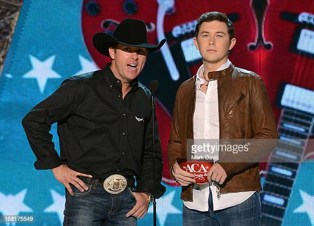 Presenters Trevor Brazile and Scotty McCreery speak onstage during the 2012 American Country Awards at the Mandalay Bay Events Center on December 10...