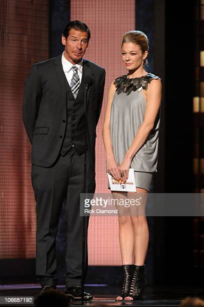 Presenters Ty Pennington and LeAnn Rimes speak at the 44th Annual CMA Awards at the Bridgestone Arena on November 10 2010 in Nashville Tennessee