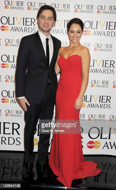 Presenters Zach Braff and Susannah Fielding pose in the press room at the 2012 Olivier Awards held at The Royal Opera House on April 15 2012 in...