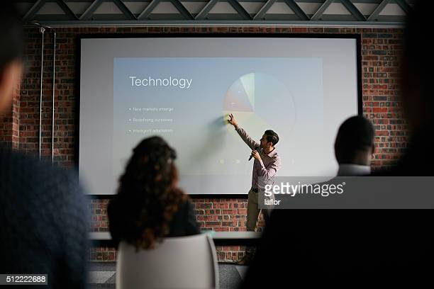 presenting key notes to his colleagues - projection screen stock pictures, royalty-free photos & images