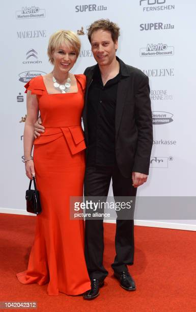 Presentor Andrea Ballschuh and her husband Jem Atai arrive to the ceremony for the media prize 'Golden Hen' at the Theater am Potsdamer Platz in...