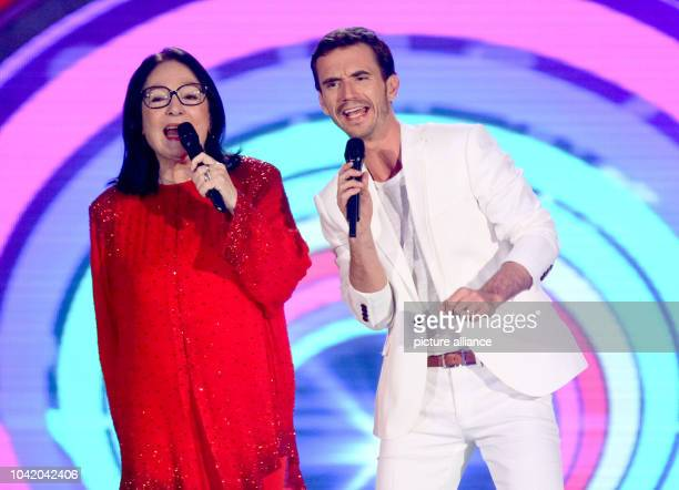 Presentor Florian Silbereisen and Greek singer Nana Mouskouri during the live broadcast of 'Das Sommerfest am See' at the expo center in...