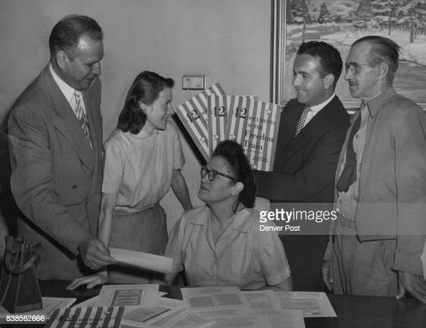 Presents Freedom Train Packets—Leo Van Dittie vice president of the Central Bank Trust company presents packets of copies of fortytwo documents which...