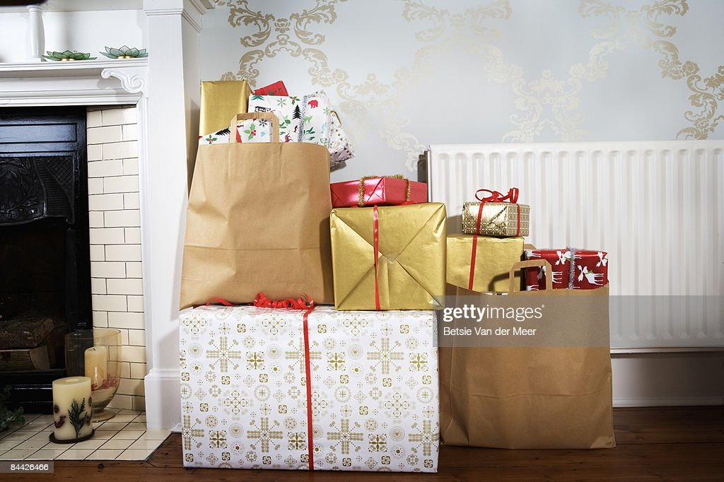 Presents in shopping bags in living room. : Stock Photo