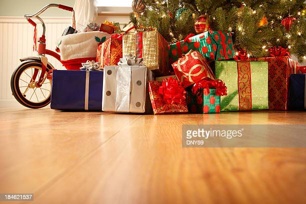 presents under the christmas tree - christmas tree stock pictures, royalty-free photos & images
