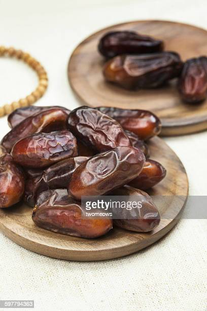 Preserved dried dates in wooden plate.