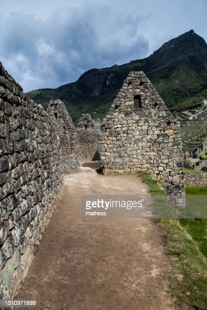preserved houses at machu picchu ruins