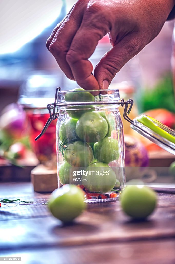 Preserving Green Tomatoes in a Jar : Stock Photo