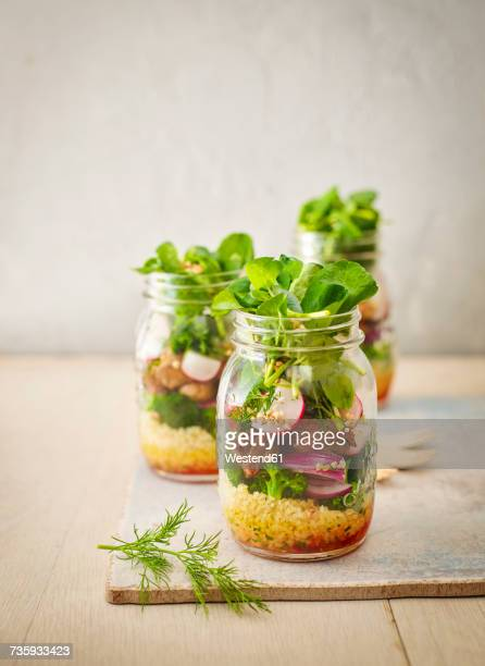 preserving jar of buckwheat salad with vegetables and diced striploin steak - jars with salad stock pictures, royalty-free photos & images