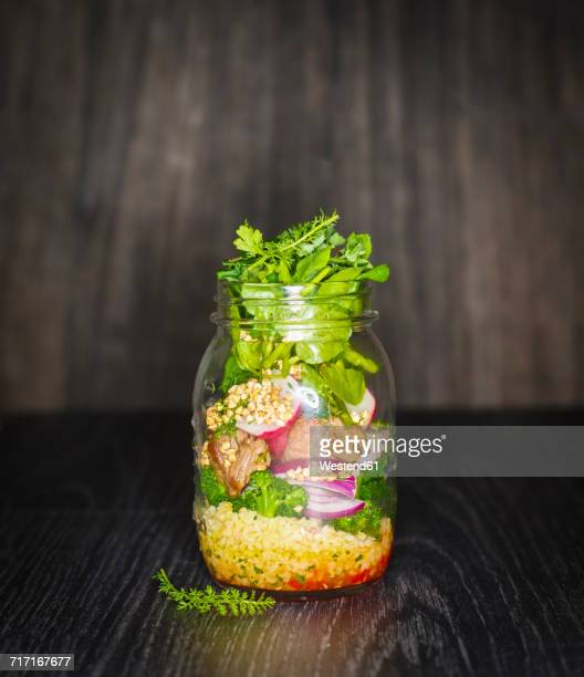 preserving jar of buckwheat salad with vegetables, coconut chips and diced striploin steak - jars with salad stock pictures, royalty-free photos & images