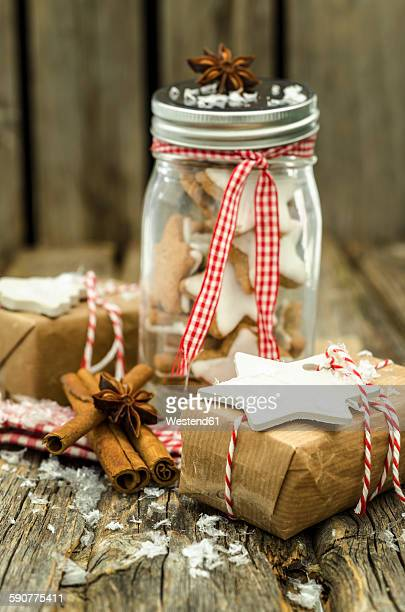 Preserving jar of home-baked cinnamon stars and Christmas presents