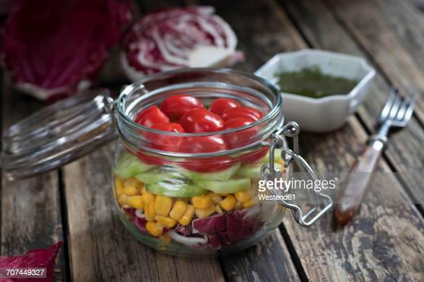 Preserving jar of salad with different vegetables