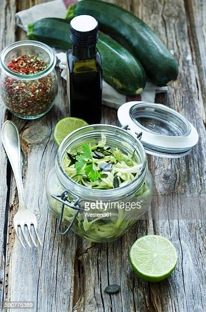 preserving jar of sliced courgettes with lime and spices - flat leaf parsley stock pictures, royalty-free photos & images