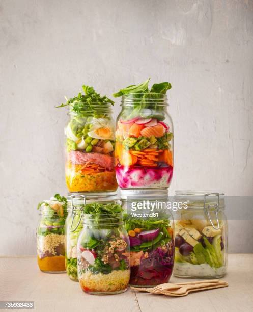 preserving jars with various salads - nut food stock photos and pictures