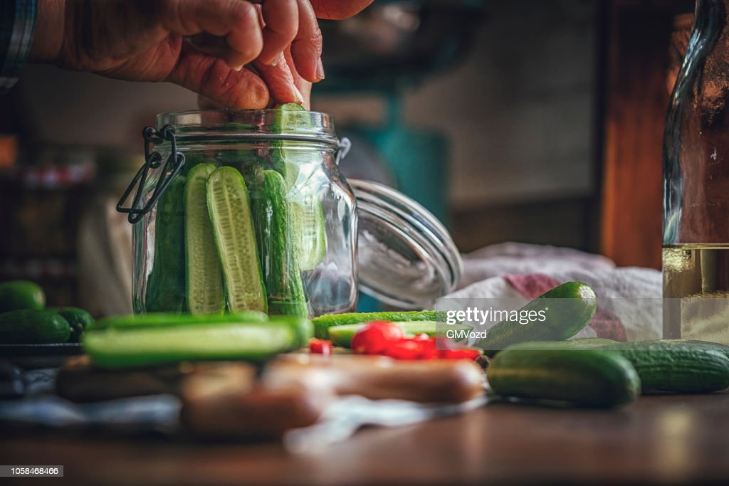 Preserving Organic Cucumbers in Jars : Stock Photo