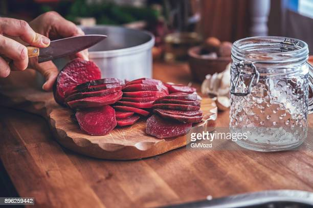 preserving organic red beet in jars - pickled stock pictures, royalty-free photos & images