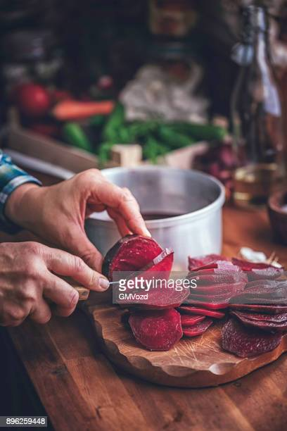 preserving organic red beet in jars - pickled stock photos and pictures