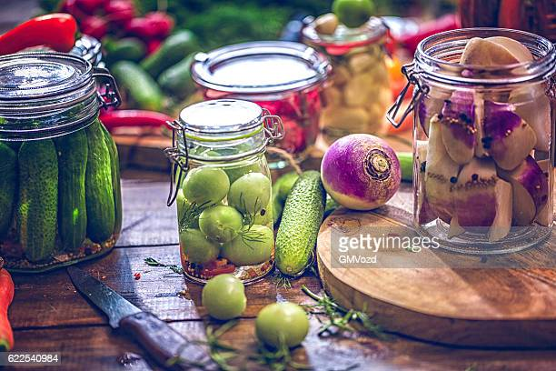 preserving organic vegetables in jars - fermenting stock pictures, royalty-free photos & images