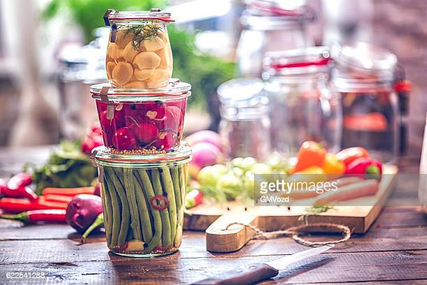 preserving organic vegetables in jars - canned food stock pictures, royalty-free photos & images