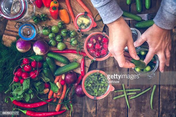 preserving organic vegetables in jars - pickled stock pictures, royalty-free photos & images