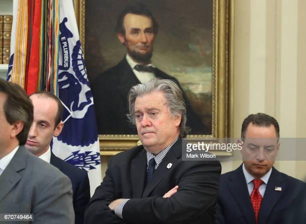 Presidenital advisor Stephen Miller Presidential advisor Steve Bannon and White House Chief of Staff Reince Priebus listen as US President Donald...