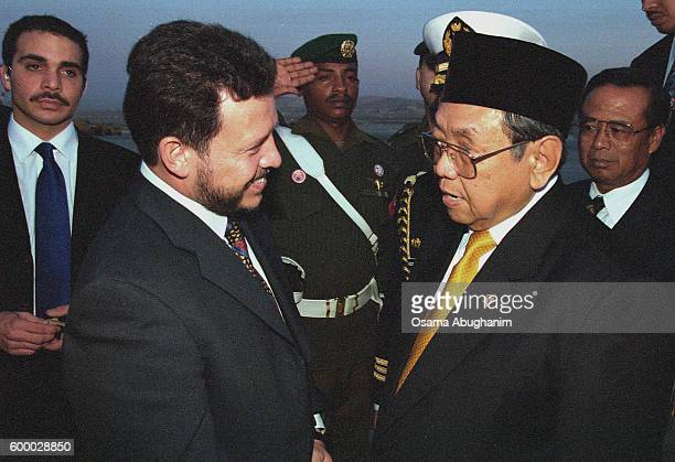 President Abdurrahman Wahid is welcomed by King Abdullah II on his arrival in Amman