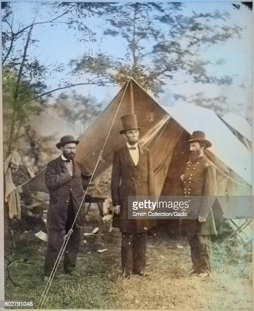 President Abraham Lincoln flanked by civil war officials standing outside of a tent 1863 Image courtesy National Archives Note Image has been...