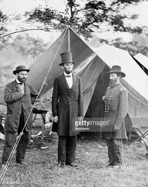 President Abraham Lincoln flanked by Major Allan Pinkerton of the Pinkerton National Detective Agency and General John A McClernand visits the Union...