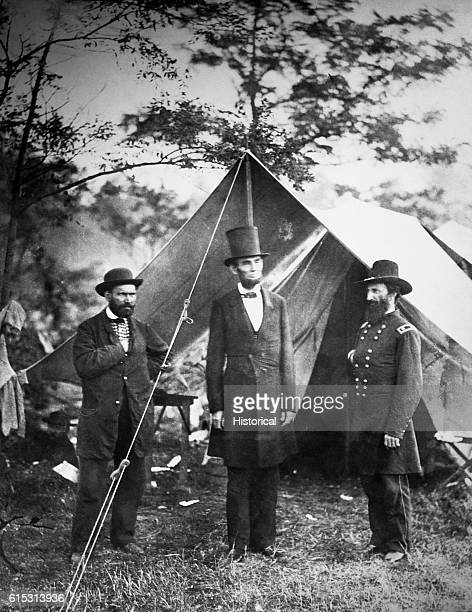 President Abraham Lincoln meets with Major Allan Pinkerton and General John A. McCleland at the Union camp on the battlefield at Antietam Creek,...