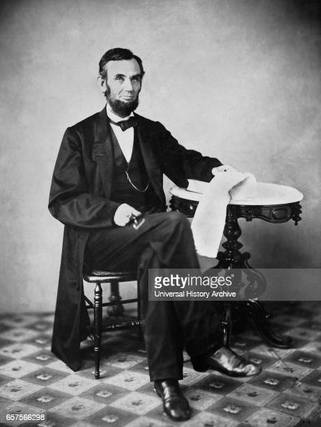 US President Abraham Lincoln Portrait Seated next to Table Washington DC USA by Alexander Gardner August 1863