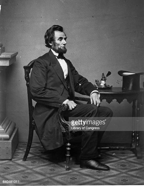 President Abraham Lincoln Sitting at a Table