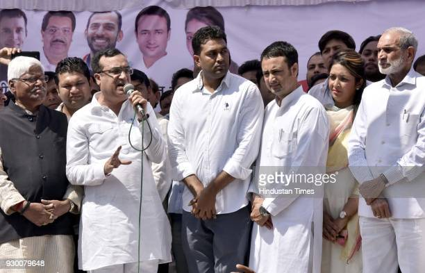 DPCC president Ajay Maken with other senior leaders addressing youth congress activist during the oath taking ceremony of the newlyelected president...