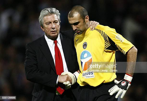 PSG President Alain Cayzac shakes hands with Paris goalkeeper Jerome Alonzo after the French League Cup match between Olympique Lyonnais and Paris...