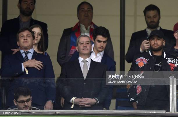 CONMEBOL president Alejandro Dominguez Brazilian Fooball Federation president Rogerio Caboclo and Brazilian footballer Neymar Jr listen to national...