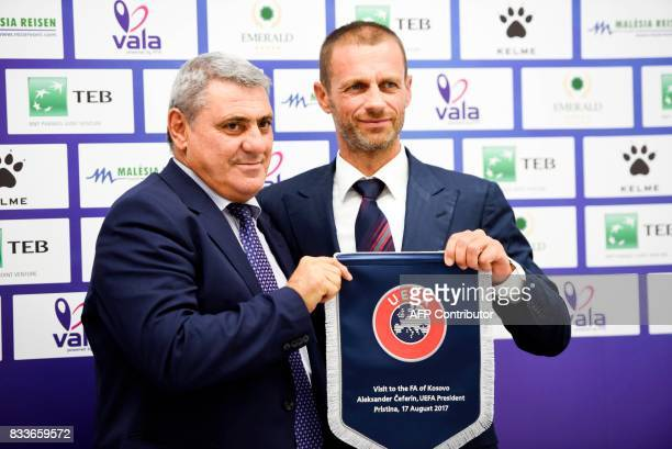 UEFA president Aleksander Ceferin and the president of the Football Federation of Kosovo Fadil Vokrri pose with a UEFA flag following a press...