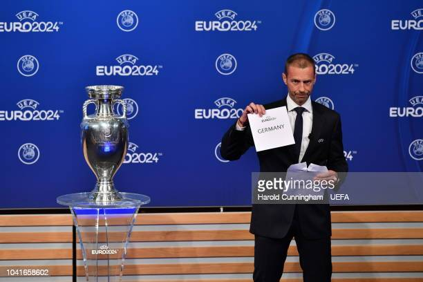 President Aleksander Ceferin announces Germany as the winners of the EURO 2024 bid during the UEFA EURO 2024 host city announcement at the UEFA...