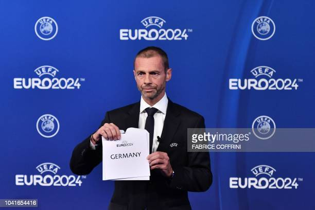 UEFA president Aleksander Ceferin announces that Germany was elected to host the Euro 2024 fooball tournament during a ceremony at the headquarters...
