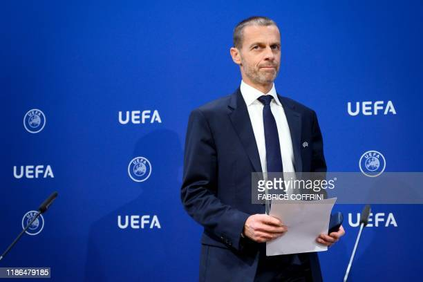 UEFA president Aleksander Ceferin arrives to hold a press conference following a meeting of the executive committee at the UEFA headquarters in Nyon...