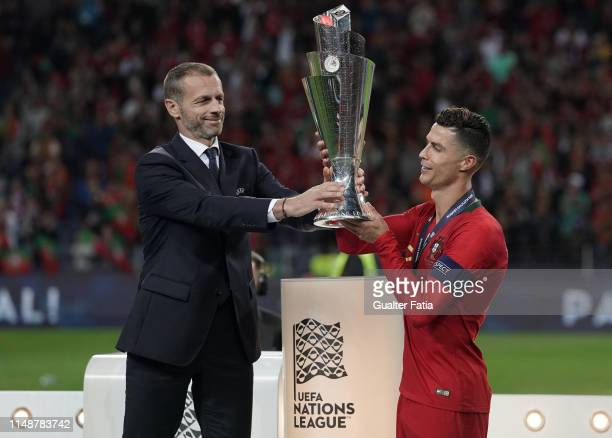 UEFA president Aleksander Ceferin gives the trophy to Cristiano Ronaldo of Portugal and Juventus after winning the UEFA Nations League at the end of...
