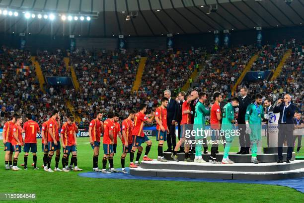 President Aleksander Ceferin gives the winners' medals to Spain's players after Spain won the final match of the UEFA U21 European Football...