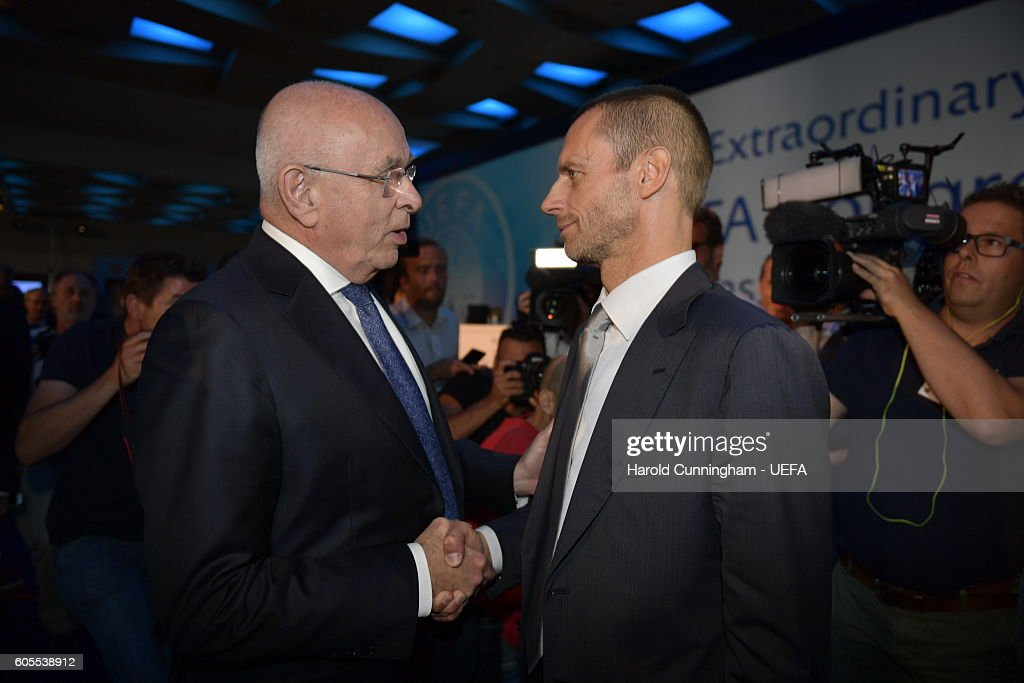 President Aleksander Ceferin is congratulated by presidential candidate Michael van Praag after the 12th Extraordinary UEFA Congress at the Grand Resort Lagonissi Hotel, on September 14, 2016 in Athens, Greece.