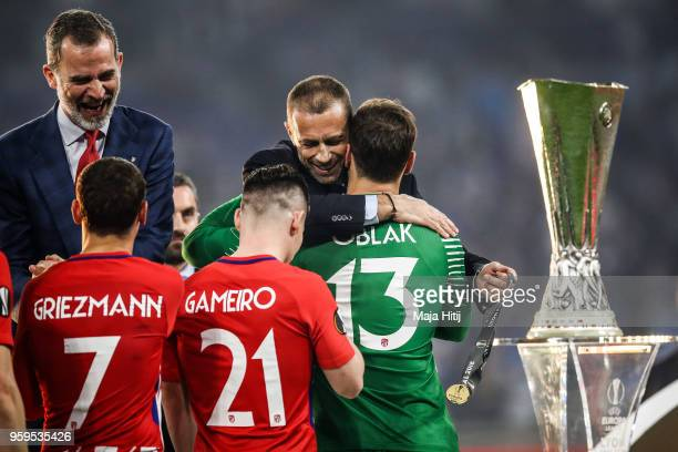 President Aleksander Ceferin presents winners medal to Jan Oblak of Atletico Madrid after the UEFA Europa League Final between Olympique de Marseille...