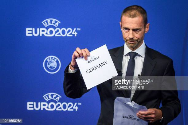 UEFA president Aleksander Ceferin shows the name of Germany elected to host the Euro 2024 fooball tournament during a ceremony on September 27 2018...