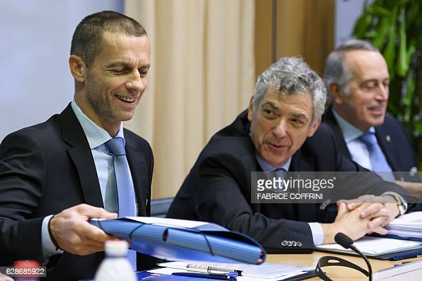 President Aleksander Ceferin smiles next to UEFA first vice-president Angel Maria Villar Llona during the opening of an executive meeting at the...