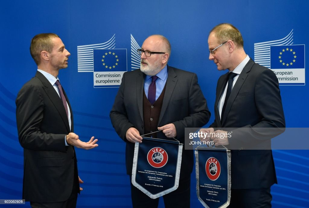 President Aleksander Ceferin (L) speaks to EU Commissioner for Education, Culture, Youth and Sport Tibor Navracsics (R) and First Vice-President of the European Commission in charge of Better Regulation, Inter-Institutional Relations, the Rule of Law and the Charter of Fundamental Rights Frans Timmermans during the signature of the Agreement for Cooperation between the European Commission and the Union of European Football Associations (UEFA) at the EU Headquarters in Brussels, on February 21, 2018. /