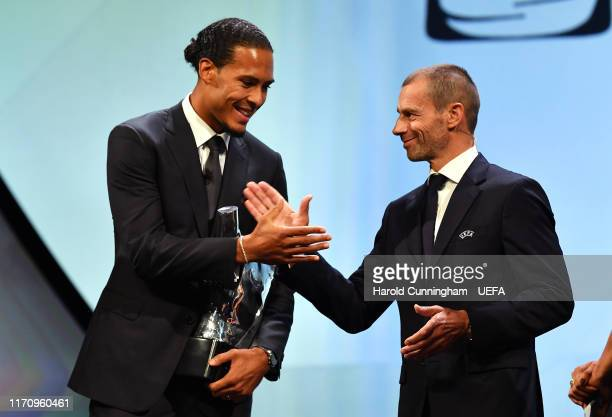 President Aleksander Čeferin presents Virgil van Dijk with the UEFA Men's Player of the Year 2018/19 Award during the UEFA Champions League Draw part...