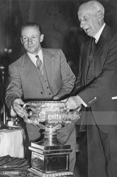 MCC President Alexander HoreRuthven 1st Earl of Gowrie presents Australian cricketer Don Bradman with a replica of the Warwick Vase at a farewell...