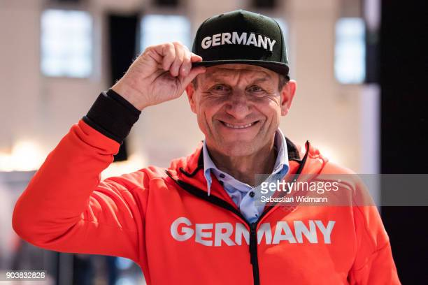 DOSB president Alfons Hoermann poses while trying on a hat at the 2018 PyeongChang Olympic Games German Team Kit Handover at Postpalast on January 11...